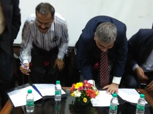 Prof. Shaligram and Prof. Kshirsagar signing MoU as witness.